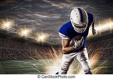 Football Player with a Blue uniform running on a stadium.