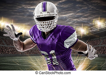 Football Player with a purple uniform making a tackle on a...