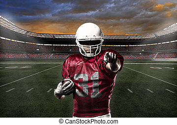 Football Player with a Red uniform celebrating with the...