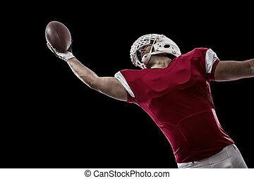 Football Player with a red uniform making a catching on a...