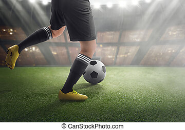 Football player with ball on the match