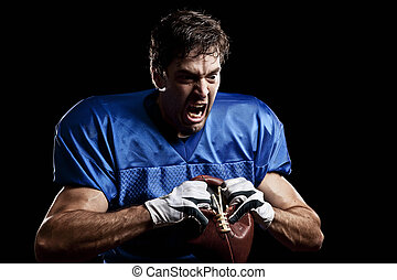 Football Player with number on a blue uniform and a ball in...