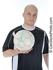 Football player with the ball in his hands.
