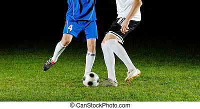 football players in action for the ball