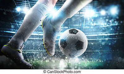 Football scene at night match with close up of a soccer player running to kick the ball at the stadium