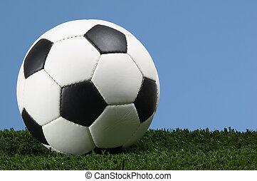Football - Soccer ball against blue sky