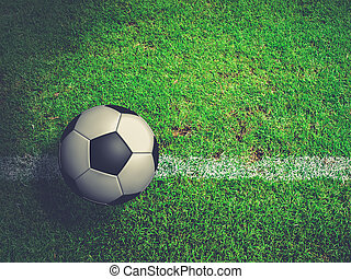Football ( soccer ball ) in green grass field.