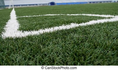 football Soccer field corner with green artificial grass...