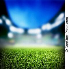 Football, soccer match. Grass close up, lights on the...