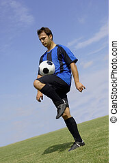 Football - Soccer Player Juggling