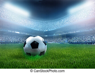football - close up of a football ball on a full stadium