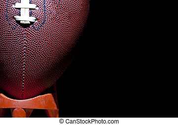 Football - close up of an american football against a black...