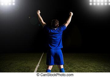 Football striker celebrates after winning