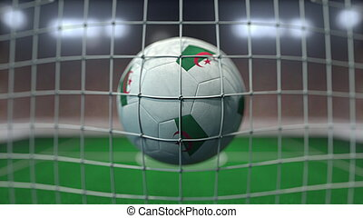 Football with flags of Algeria hits goal net. 3D rendering