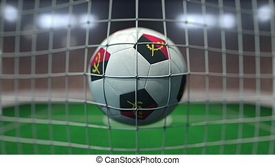 Football with flags of Angola hits goal net. 3D rendering