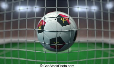 Football with flags of Angola hits goal net. Slow motion 3D animation
