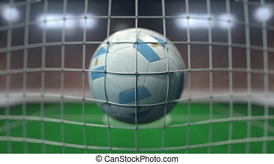 Football with flags of Argentina hits goal net. Slow motion 3D animation