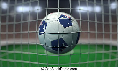 Football with flags of Australia hits goal net. 3D rendering