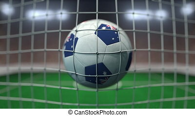 Football with flags of Australia hits goal net. Slow motion 3D animation