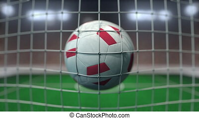 Football with flags of Austria hits goal net. Slow motion 3D animation
