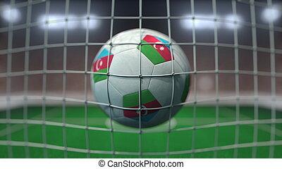 Football with flags of Azerbaijan hits goal net. 3D rendering