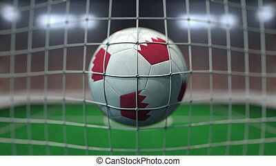 Football with flags of Bahrain hits goal net. 3D rendering
