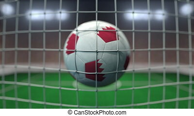 Football with flags of Bahrain hits goal net. Slow motion 3D animation