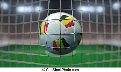 Football with flags of Belgium hits goal net. 3D rendering