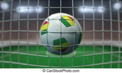 Football with flags of Bolivia hits goal net. Slow motion 3D animation