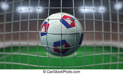 Football with flags of Cambodia hits goal net. 3D rendering