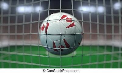 Football with flags of Canada hits goal net. 3D rendering