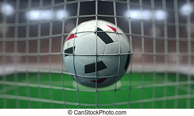 Football with flags of Egypt hits goal net. 3D rendering