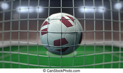 Football with flags of Latvia hits goal net. 3D rendering