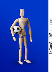 Football wooden toy figure on blue