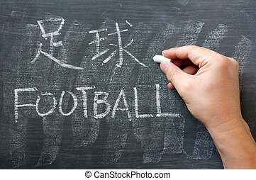Football - word written on a blackboard with a Chinese version