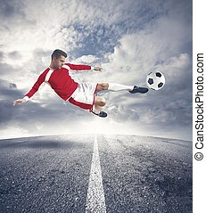 Footballer - A young footballer play in the street