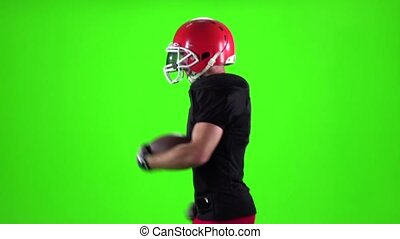 Footballer shifts the ball from hand to hand. Slow motion