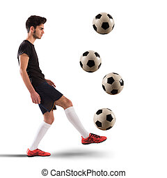 Footballer teenager - Teenage soccer player dribbling with...