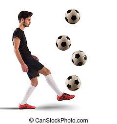 Footballer teenager - Teenage soccer player dribbling with...