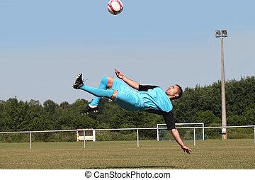 footballeur, dans plein vol, dos, coup de pied