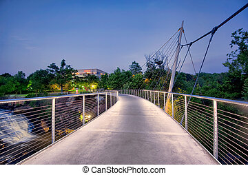 This is the footbridge crossing the Reedy river at Falls Park in Greenville, SC