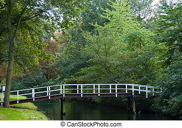 Footbridge over canal - Small wooden footbridge over a canal...