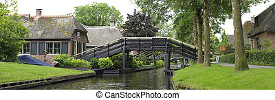 footbridge over canal - the idyllic Village of Giethoorn,...