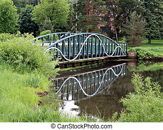 Footbridge Reflecting in Pond - Blue footbridge made of iron...