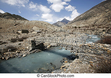 footbridge - Wooden footbridge on the annapurna circuit,...