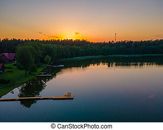 Footbridge to the lake in a sunset