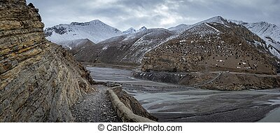 Footbridge With Mountains in Background