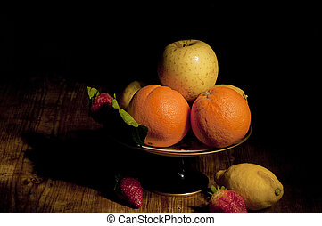 footed plate with fruit