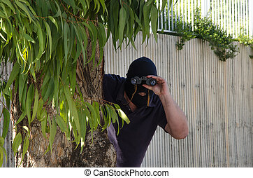 Footpad stares at you through binoculars - Footpad in...
