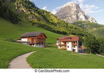 footpath in picturesque alpine village Colfosco (Ladin: Calfosch